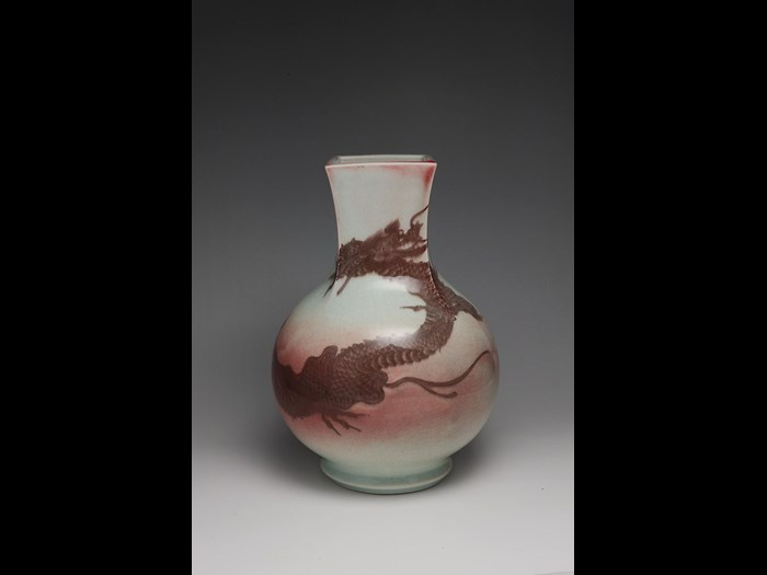 Bottle vase by Miyagawa Kozan with dragon design in underglaze copper red, c.1880 - 90.