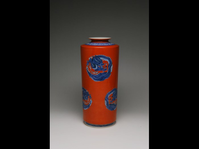 Red cylinder vase with blue dragon roundels by Seifu Yohei III. c1890.