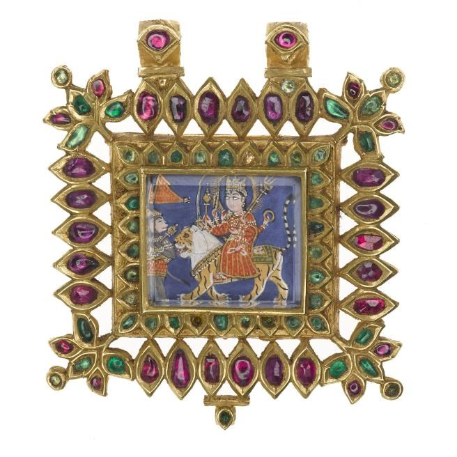 Gold pendant inlaid with rubies and emeralds depicting the Hindu goddess Devi