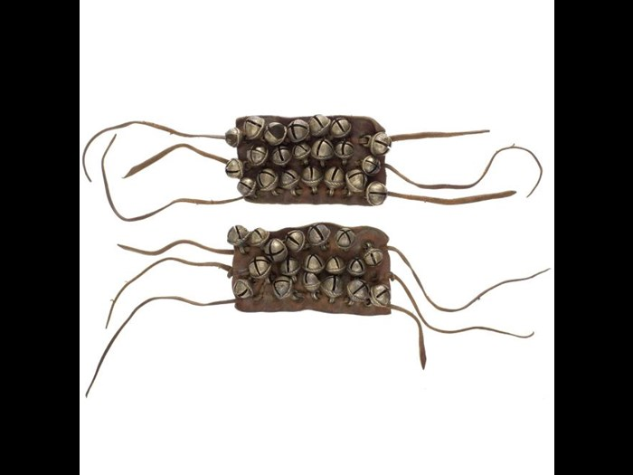 Pair of leather anklets with brass pellet bells attached, worn by dancers. India, Rajasthan, Nagaur district, mid 20th century.