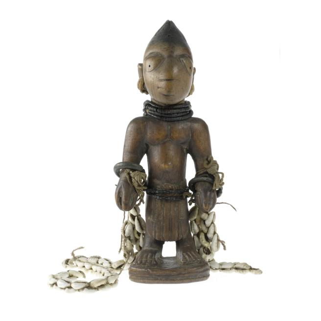 Male figure, one of a pair of ere ibeji figures, made in southwestern Nigeria.