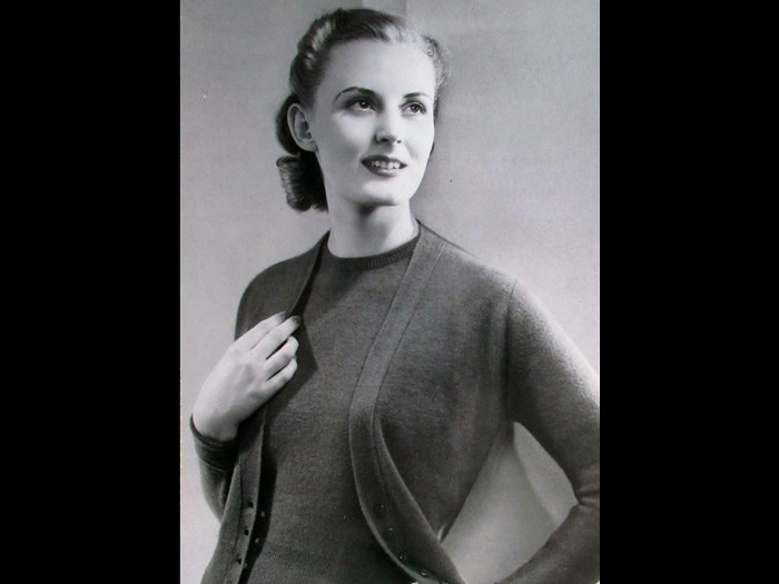 Model wearing a twinset from a Pringle catalogue, 1940s.