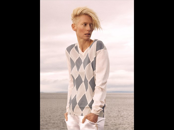 Tilda Swinton wearing an argyle pattern sweater, photographed by Ryan McGinley in 2010.