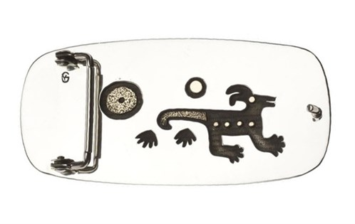 The back side of the belt buckle is silver and incorporates designs using the underlay technique: Yazzie Johnson and Gail Bird, 2009