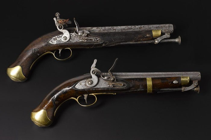 Pair of cavalry pistols, marked to the King's German Hussars, found on the battlefield at Waterloo.