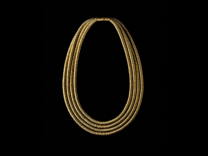 Gold Shebyu Collar Consisting Of Four Rows Rings Threaded On A Pad