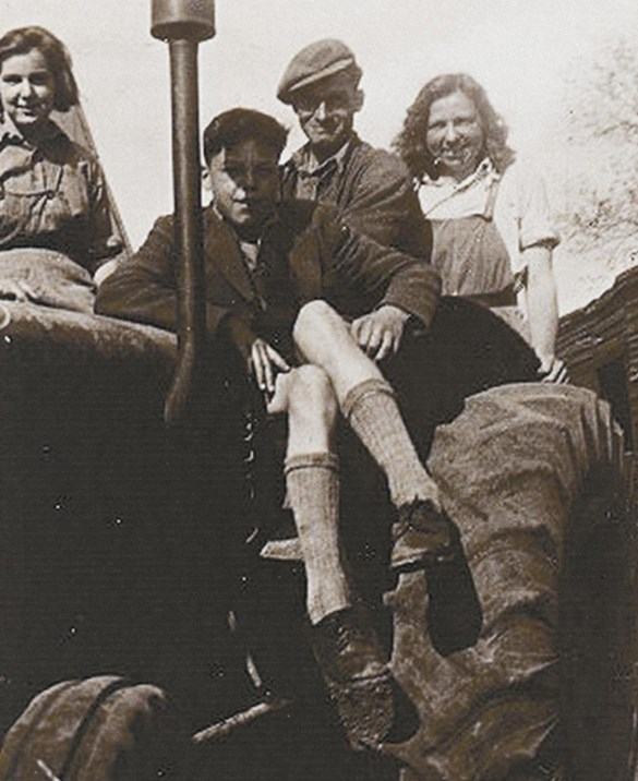 Landgirl with group on Fordoson tractor 1946
