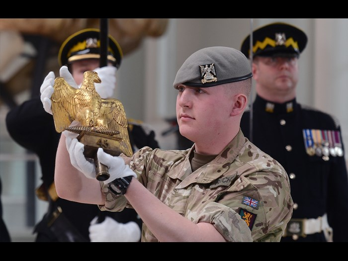 The youngest serving soldier from the Royal Scots Dragoon Guards presenting Ewart's Eagle.