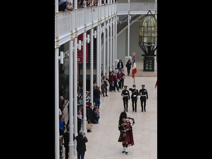 Soldiers of the Royal Scots Dragoon Guards marching the replica standard and eagle through the Grand Gallery.