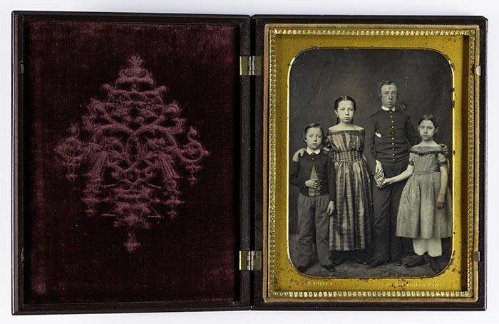 Daguerreotype of two girls and two boys