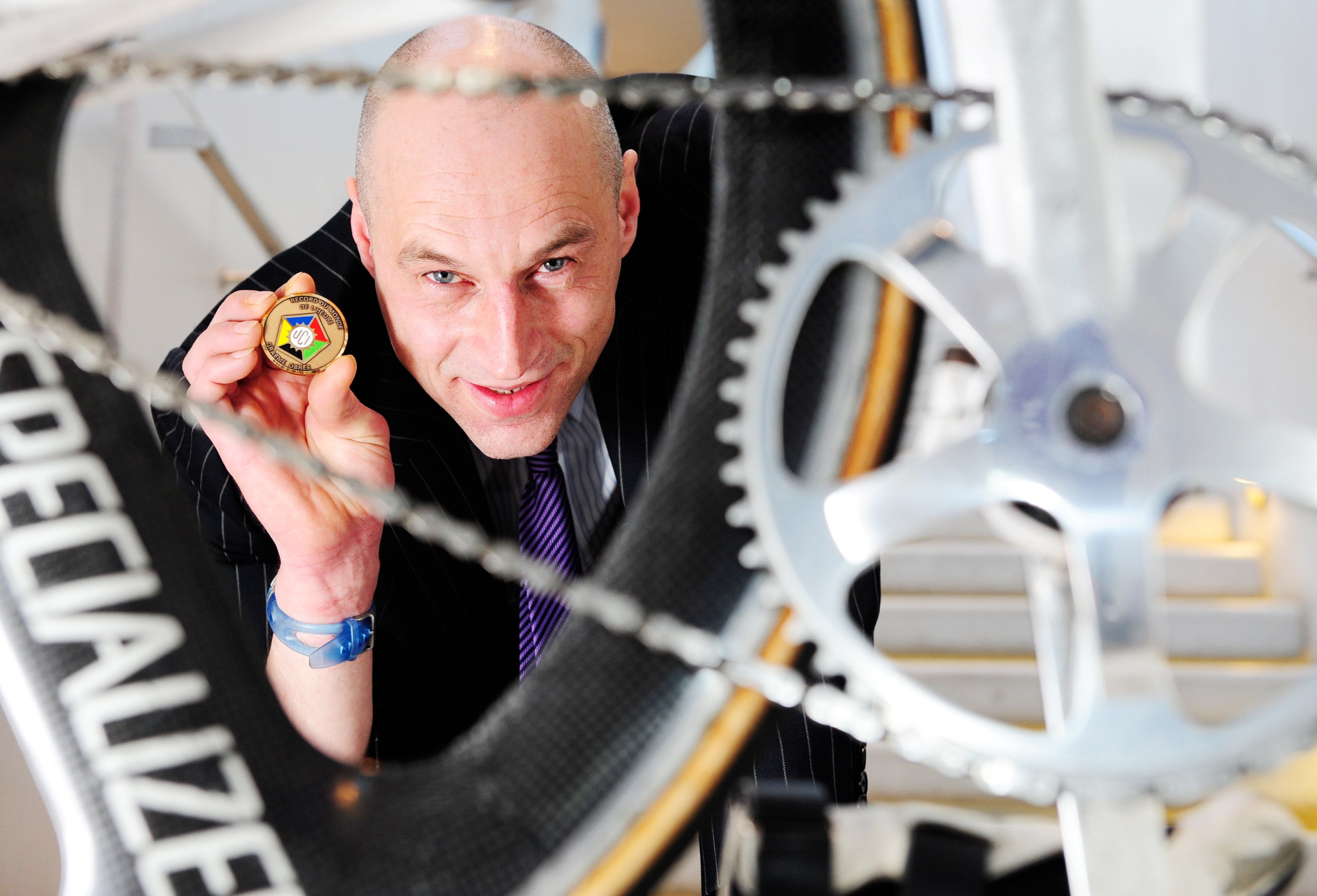 Graeme Obree with his 1993 World Hour Record medal, awarded by the Union Cycliste Internationale.