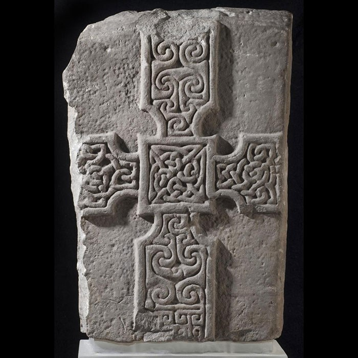 Slab of grey sandstone with a cross on one side. From Monifieth, Angus, Scotland, c. AD 700–800.
