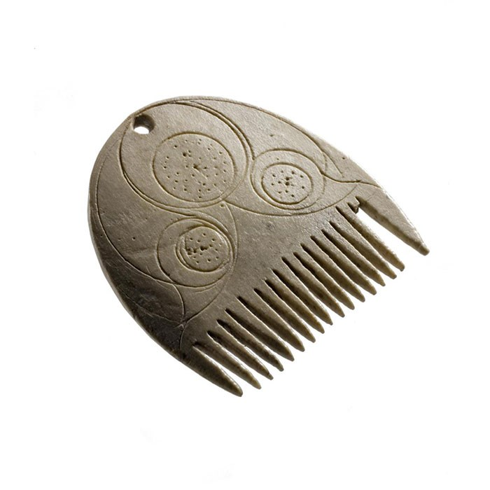 Comb made of bone, probably used to comb a beard or moustache, from Langbank Crannog, Renfrewshire, 0-200 AD.
