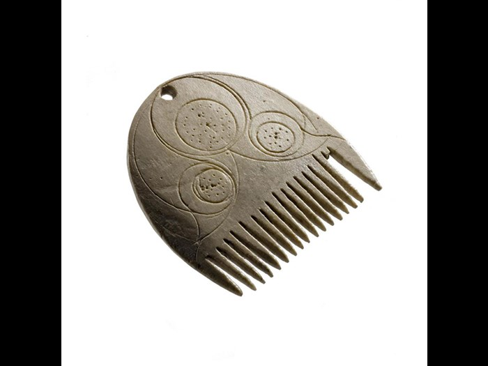 Comb made of bone, probably used to comb a beard or moustache, from Langbank Crannog, Renfrewshire, AD 1-200.