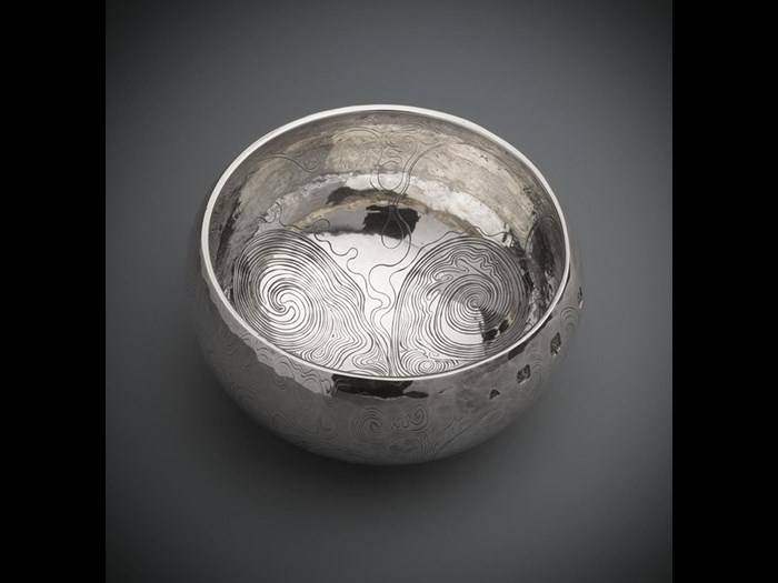 Silver bowl engraved on the exterior with irregular running scrollwork by Malcolm Appleby.