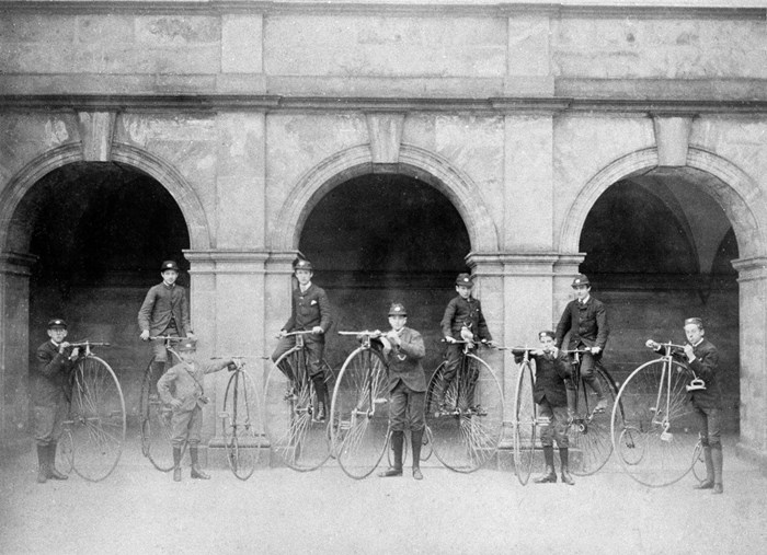 A group of schoolboys with their high bicycles, outside Madras College, St Andrews, Fife, c. 1860s