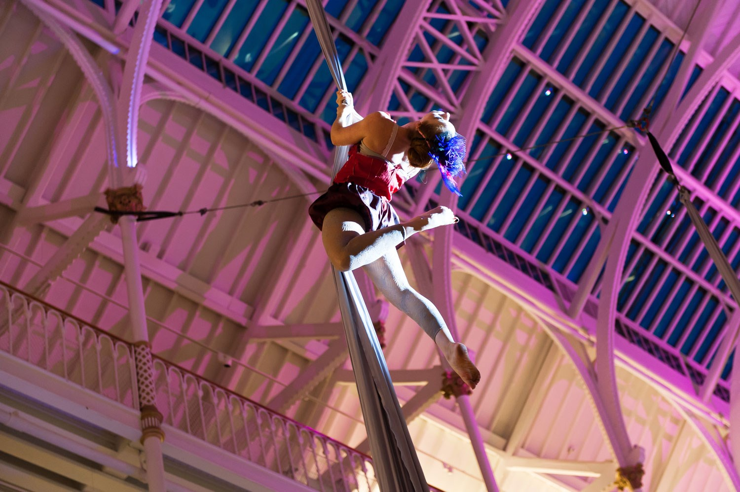 Aerial artist performing in the Grand Gallery