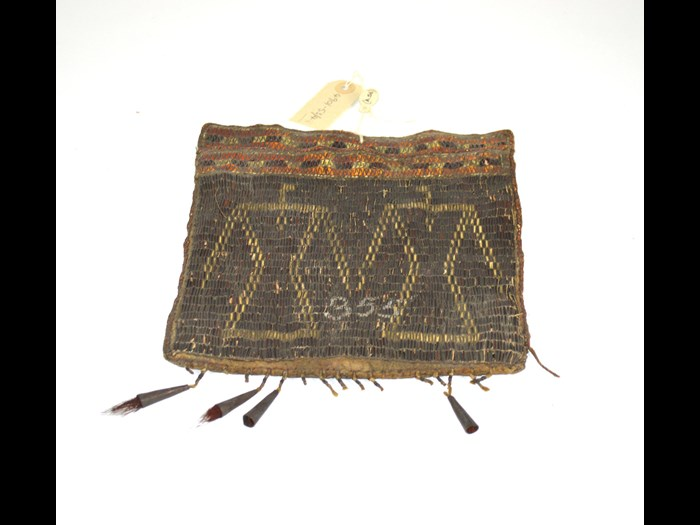 Algonquian bag decorated with porcupine quillwork of double thunderbird design, late 18th-mid 19th century. The number 355 may relate to numbers used in the model room, which comprised of the earliest collections in what is now the Royal Engineers Museum. This bag was mistakenly associated with South African collections until the 1990s. © Royal Engineers Museum, Library and Archive.