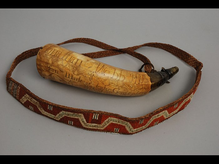 Powder horn inscribed with names James Cameron of 42nd Highland Regiment (Black Watch) and Jonathan Webb, dated 1758. The strap, adapted from a burden strap (or tumpline) of vegetal fibre and moosehair false embroidery is of the type known to be supplied to the regiment for tying blanket roles. Burden straps are Iroquois and Huron in manufacture. (M.1931.581)