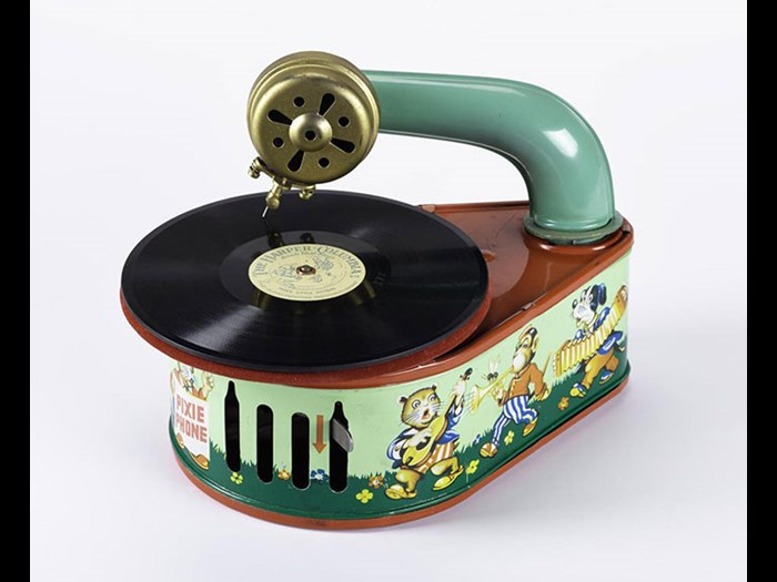 Pixie Phone toy gramophone in pear-shaped tinplate case decorated with animal musicians, in maker's carton, by Gama, Germany, 1950.