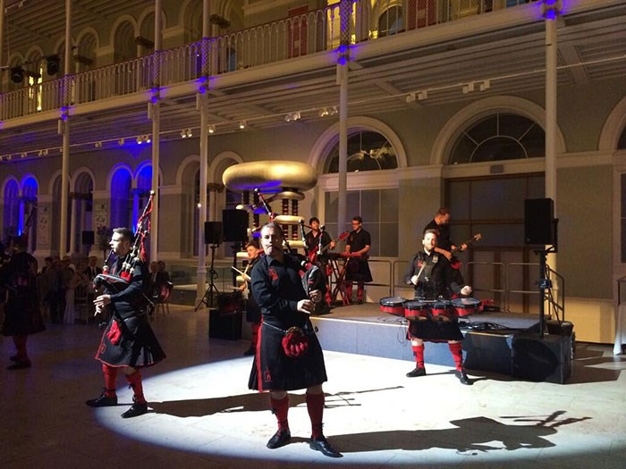 The Red Hot Chilli Pipers performing in the Grand Gallery