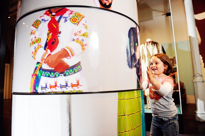 Girl spinning an interactive in the Patterns of Life gallery